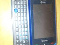 Blue LG AT&T  phone with slide out keyboard. Works