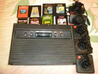 I HAVE AN ATARI CX2600 CONSOLE, 5 JOYSTICKS & EIGHT