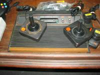 Total Atari video game system with 2 controllers, been