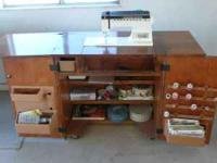 Nice Singer with nice cabinet. Instruction Manuel and