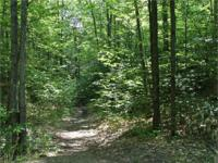 Great hunting property with hardwoods and trails. Hunt