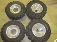 Douglas ATV aluminum rims with tires. All tires have