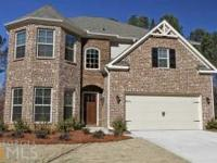 . This Spacious New Home Has Hardwood Floors In The