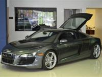 This 2009 Audi R8 2dr AWD Coupe features a 4.2L V8 FI
