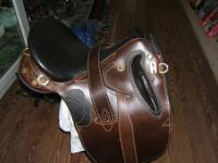 This saddle looks like it has never been on a horse it
