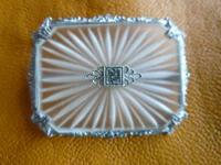 THIS ART DECO ERA pin has been looked at by an antique