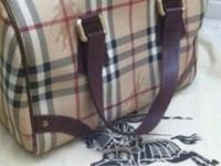 Authentic Burberry Satchel used , but in good condition