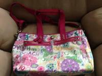 "Authentic Coach ""Poppy"" diaper bag with changing pad."