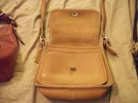 Tan in color authentic Coach purse. Its been in my