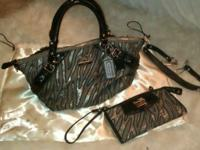 Real coach zebra print purse with the matching