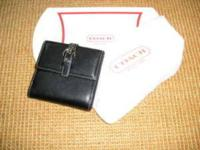 Guaranteed authentic Coach Black Soho Mini bi-fold