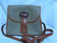 An authentic vintage Dooney & Bourke Natural/Taupe