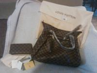 This is an authentic Louis Vuitton bag and purse. I am