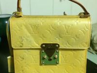 I am selling an authentic yellow Louis Vuitton purse