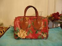 I have an authentic red floral Nordic designs handbag