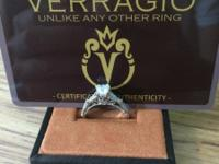A beautiful Verragio Parisian 102 diamond engagement