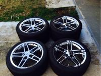 authentic factory z06 corvette chrome rims and tires.