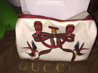 I have an authentic Gucci purse for sale its white with