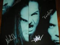 The poster is autographed by all 4 members of Static-X