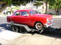This is a vintage car carrier (trailer) that I use very