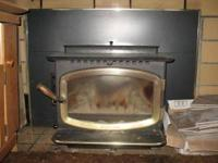 This pellet stove was the main source of heat in a
