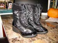 New Avon black fur lined boots Size 6. Never used.