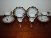FOUR DEMI TASSE SETS OF CUPS AND SAUCERS, MADE IN