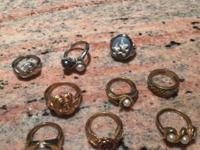 This is a LOT of 6 gold tone rings and 3 silver tone