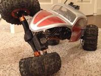 Axial ax10. Has brushless ESC, brushed first class