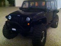 Selling my Axial SCX10 Jeep Rubicon. Black with hard