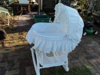 Beautiful white bassinet with a sun bonnet and a basket