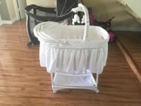 Brand new all white baby bassinet like new barely