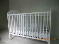White wooden baby bed ,with matching mattress, it's