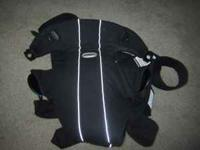 Black Baby Bjorn front pack carrier. Great to have baby