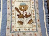 Complete infant boys room in a sports bear theme. Thick