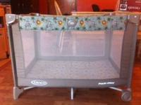 One travel baby play pen.  - $20 One high chair - $20