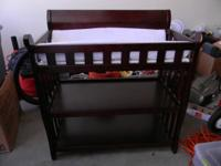 Gently used cherry wood baby changing table. Changing