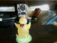 Chick with flowers, about 6 inches tall, lights up with