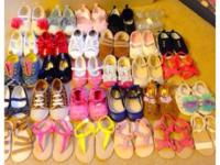 Baby clothes & & shoes for a little woman. All are in