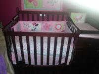 iM SAILING A BABY CRIB COMES WITH MINNIE MOUSE COVERS
