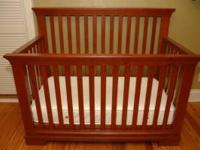 Maple finish baby crib and mattress set. $125.00 obo.