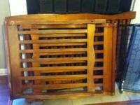 "This is ""fair"" condition darker wood crib. It has some"