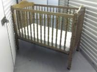 This is a older style 1999 solid oak wood crib that has
