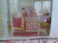 Pink, yellow and green crib set. never been used.