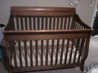 I'm selling a Shermag sleigh style baby crib with