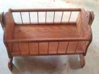 This is a solid wood, hand made baby doll crib. THIS