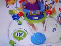 Two-in-one stationary jumper and entertainer has 12 fun
