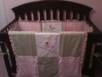 Adorable pink, green, and white crib bedding set with