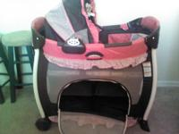 Pink and brown bassinet/pack and play. Used maybe