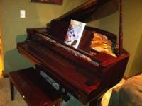 young chang baby grand piano. cherry finish, excellent